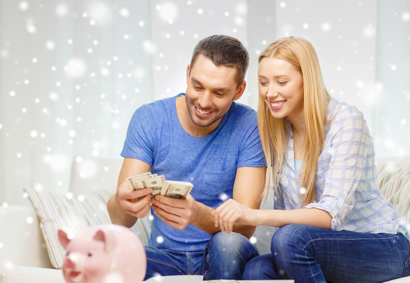 34708378 - love, family, finance, money and happiness concept - smiling couple counting money with piggybank on table at home
