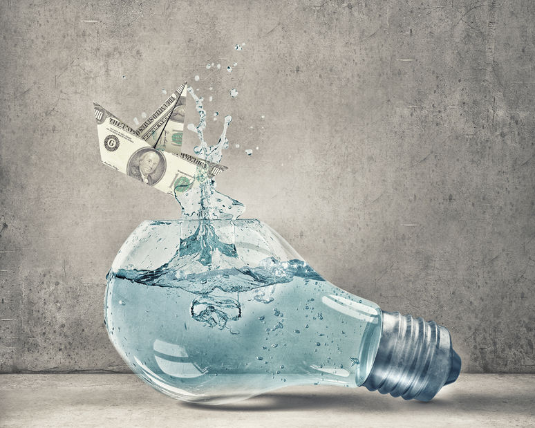 46561859 - glass light bulb filled with water and dollar ship floating inside