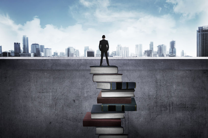 46938446 - back view business person looking the city, standing on the top of the book. education for success concept